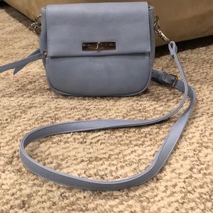 Baby blue crossover bag.
